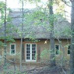 A photo of the East side of the Strawbale Studio.